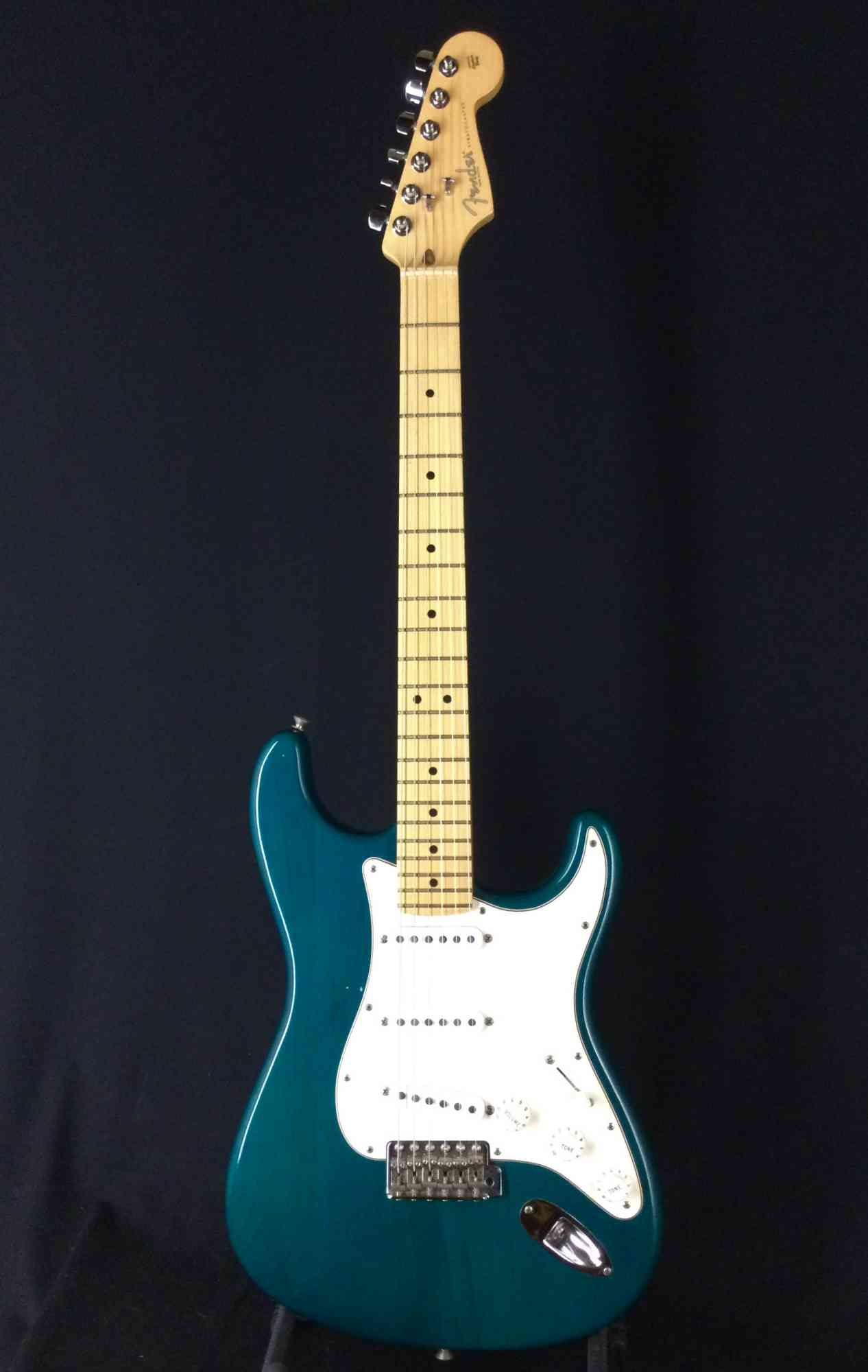 Front view of Fender Highway One Stratocaster 2002 Teal Green Transparent