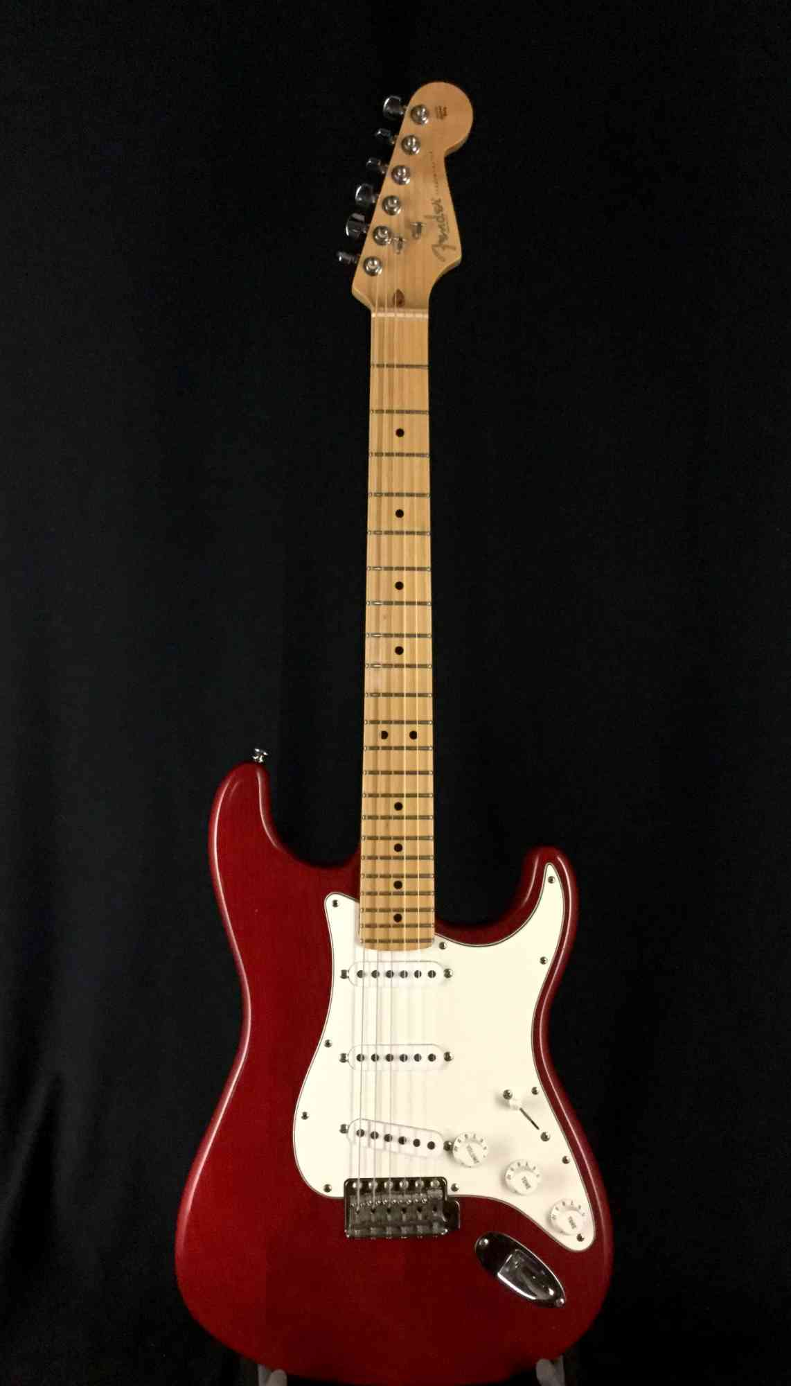 Front view of Fender Highway One Stratocaster 2003 Midnight Wine Transparent